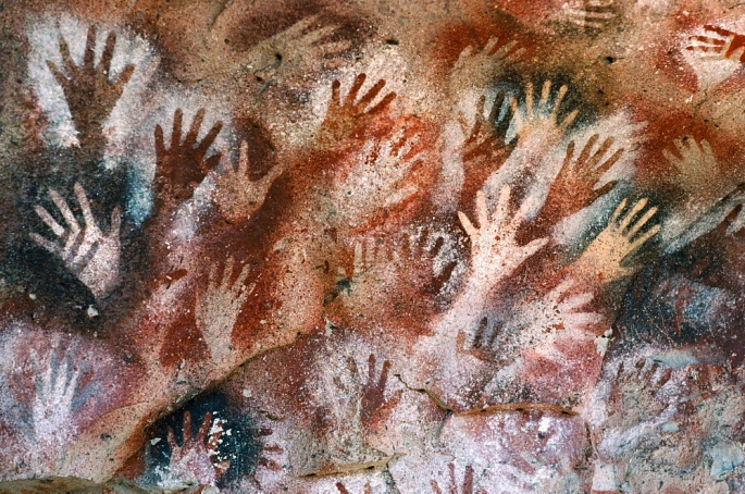 ARGENTINA Patagonia Cueva de las Manos Cave of the Hands.  Prehistoric rock paintings of human hands in red black and orange 13 000 to 9 500 years old.